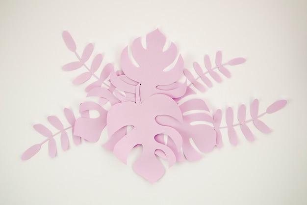 Hojas tropicales en estilo de corte de papel