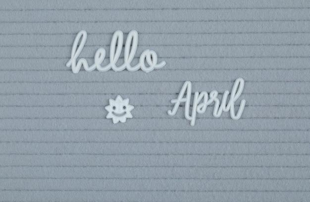 Hola cartel de abril en superficie gris.