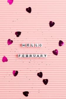 Hola febrero tipografía de texto de perlas.