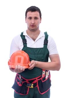 Hombre con casco en uniforme aislado en blanco