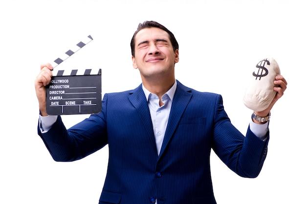 Hombre guapo con badajo de película y bolsa de dinero