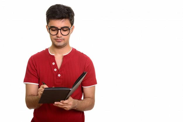 Hombre guapo joven escribiendo en diario