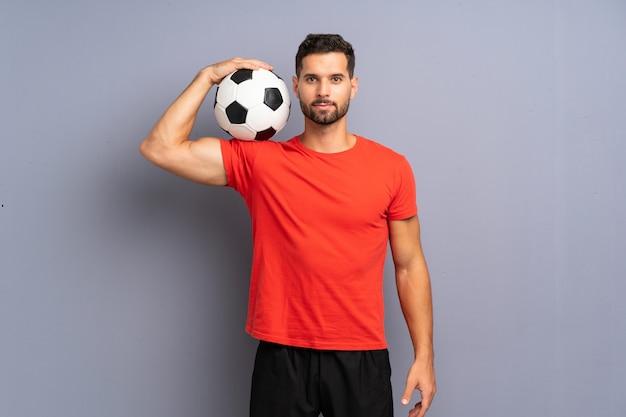 Hombre guapo joven futbolista