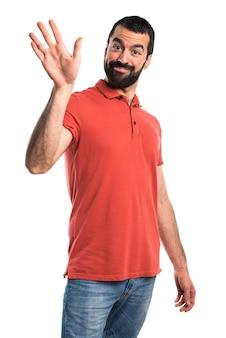 Hombre guapo saludando