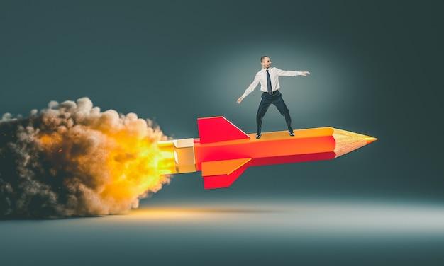 Hombre montando un lápiz cohete. concepto de creatividad y éxito.