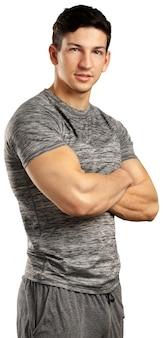 Hombre musculoso aislado en blanco