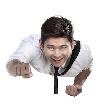 Hombre de negocios asiático volando