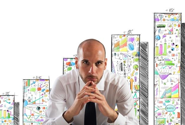 Hombre de negocios confiado con dibujo estadístico
