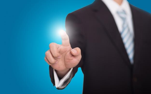 Hombre de negocios desenfocado con dedo brillante