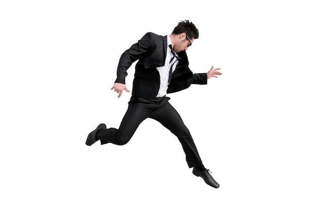 Hombre de negocios entusiasta saltando