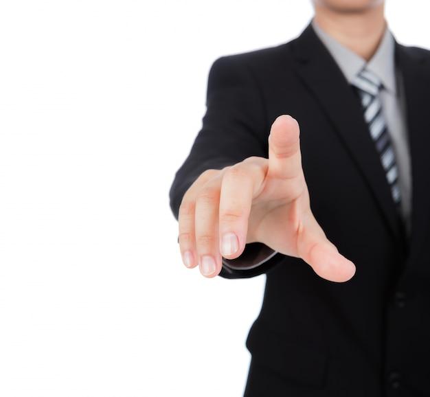 Hombre de negocios pulsando algo con su dedo índice