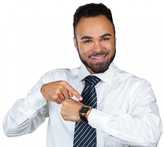 Hombre de negocios que señala en el tiempo de servicio