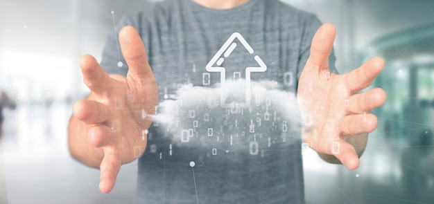 Hombre de negocios que sostiene una nube binaria con la representación 3d de la flecha del internet de la carga