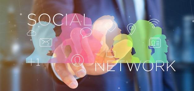 Hombre de negocios que sostiene un trabajo en equipo social colorido de la red con la representación del icono 3d