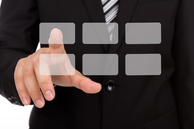 Hombre de negocios seleccionando un cuadrado gris Foto gratis