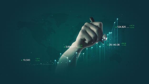 Hombre de negocios sosteniendo un gráfico de lápiz financiero y escribiendo acciones de inversión en el mercado financiero de análisis de gráfico de intercambio de tecnología de crecimiento sobre fondo de éxito con concepto de dinero de datos digitales de ganancias económicas.