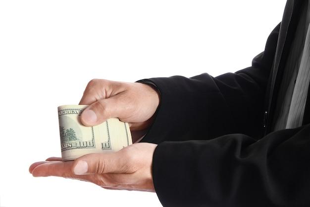 Hombre de negocios, tenencia, dinero, en, pared blanca