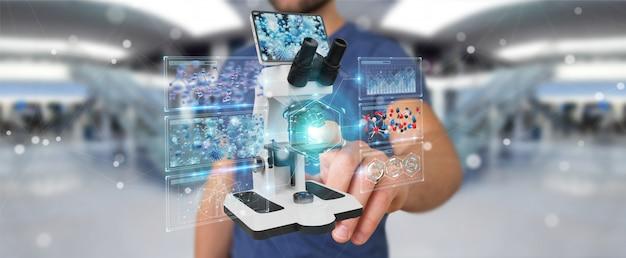 Hombre de negocios usando microscopio moderno con análisis digital