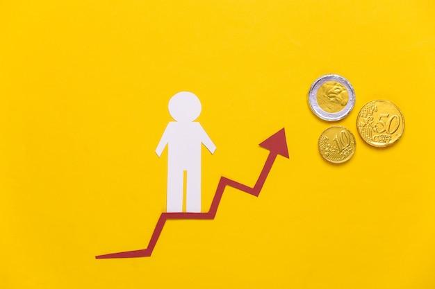 Hombre de papel en flecha de crecimiento, monedas