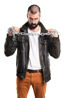 Hombre del proxeneta con las cadenas