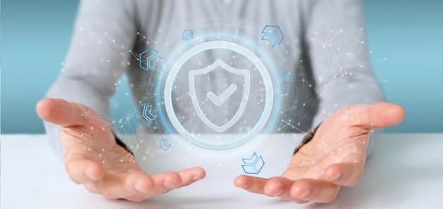 Hombre que sostiene una representación 3d del concepto de la seguridad del web del escudo