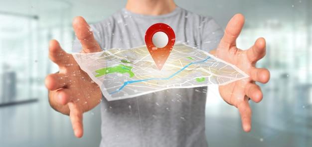 Hombre que sostiene un soporte de pin de representación 3d en un mapa