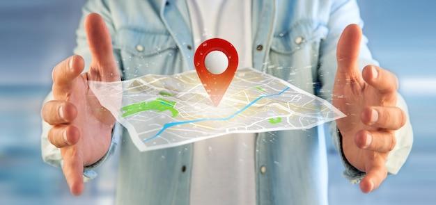 Hombre que sostiene un titular de pin en un mapa