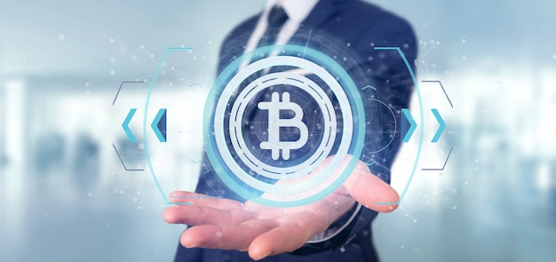 Hombre que tiene un icono de bitcoin de tecnología en una representación 3d de círculo