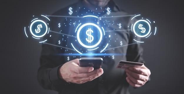 Hombre con smartphone. símbolos de dólar. la red. banca por internet