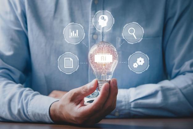 Hombres sosteniendo bombillas, ideas de nuevas ideas con tecnología innovadora y creatividad. nuevos conceptos innovadores en la tecnología de ia (inteligencia artificial) más avanzada
