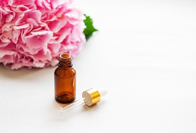 Hortensia rosa y aceite de masaje