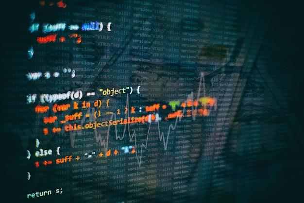 Html5 en editor para desarrollo de sitios web. código html del sitio web en la foto en primer plano de la pantalla del portátil.