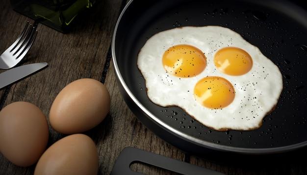 Huevo con tres yemas en sartén