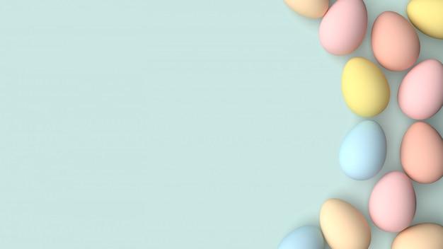 Huevos de pascua pintados en colores pastel sobre un fondo verde pastel.