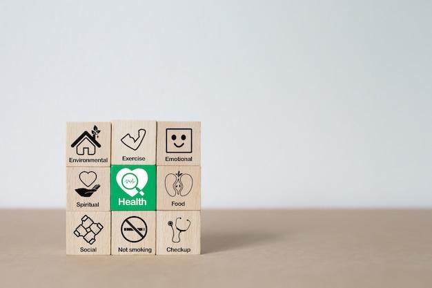 Icono gráfico de promoción de salud en bloque de madera.