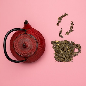 Icono de taza de té hecho de hojas de té oolong secas