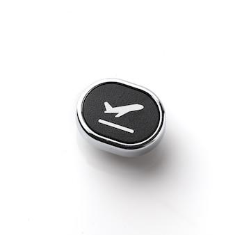 Icono de viaje en el teclado de la computadora de estilo retro para el concepto de reserva en línea