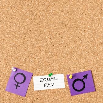 Igualdad de remuneración entre hombre y mujer, símbolos de género, vista superior