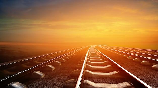 Ilustración 3d de ferrocarriles vacíos en el fondo del cielo al atardecer