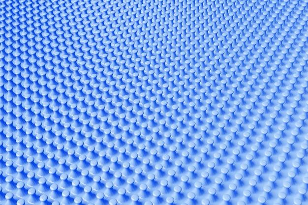Ilustración 3d de filas de protuberancias azules. un conjunto de granos sobre un fondo monocromo, patrón. fondo geométrico