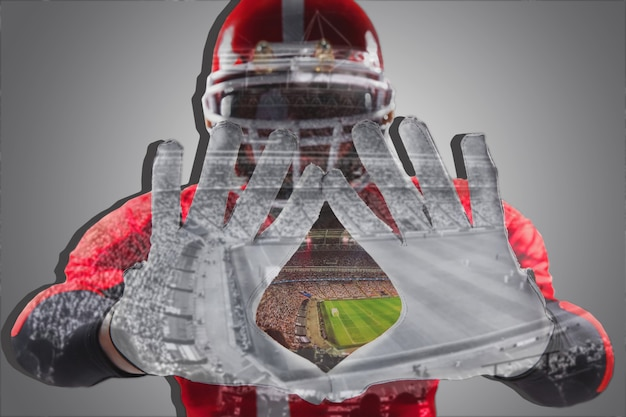 La imagen conceptual de las manos del jugador de fútbol americano con estadio