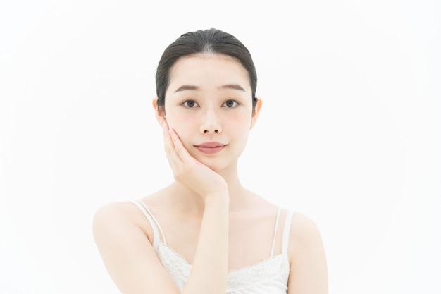 Imagen del cuidado de la piel (mujer asiática)