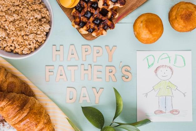 Imagen y pastelería cerca de la escritura feliz día del padre