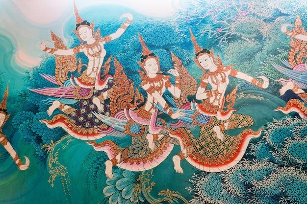 Imagen tradicional de la pintura del estilo tailandés en el templo de la pared