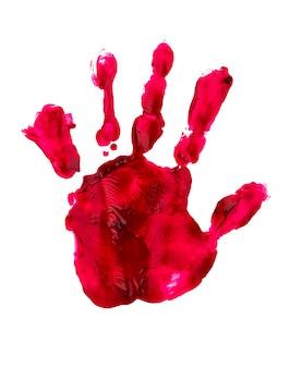 Impresión sangrienta de la mano y los dedos en la pared blanca