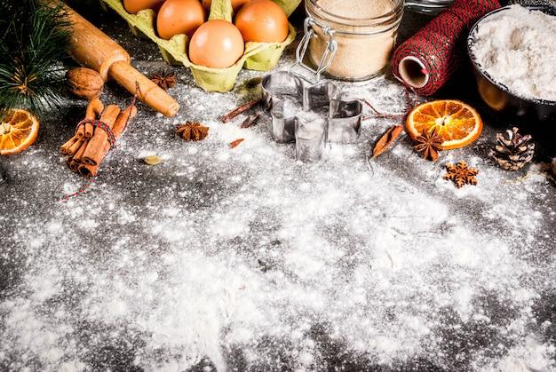 Ingredientes, especias, naranjas secas y moldes para hornear.
