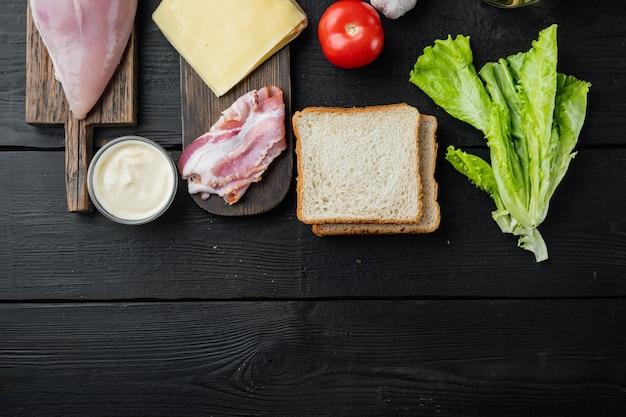Ingredientes para sándwich, tocino, queso, tomate, carne de pollo, lechuga, salsa,