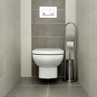 Inodoro blanco en baño moderno con soporte de papel y cepillo para inodoro.