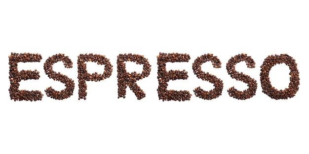 Inscripción espresso del alfabeto inglés de granos de cacao tostados