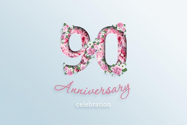 La inscripción número 90 y celebración de aniversario textis flores, en una luz